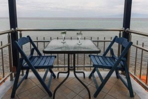 The table in the balcony and view from the Aphrodite studio