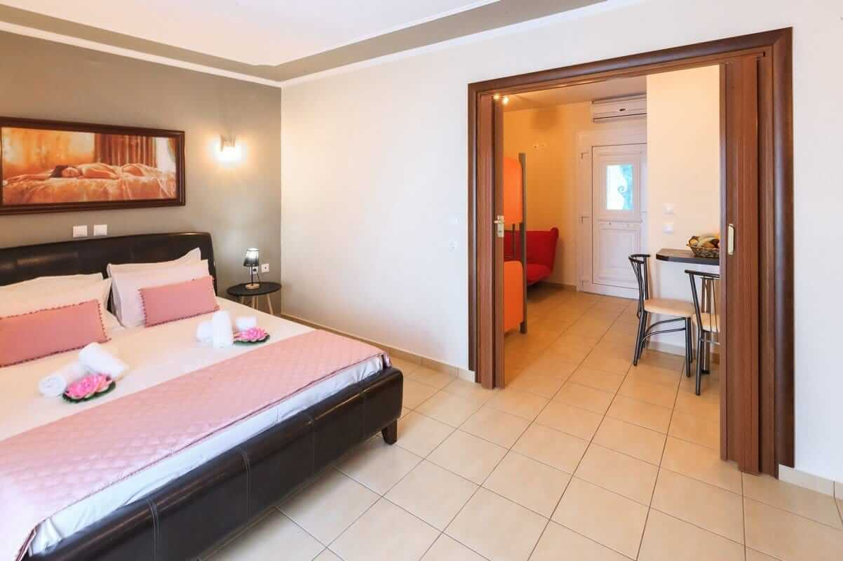 The double bed and entrance to the second room in the Zeus apartment