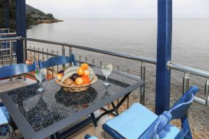 The table and view from the balcony in the Zeus Apartment, overlooking at the Aegean which is just a few meters below.