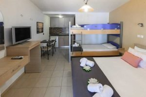 The overlay of the Filoxenia Family studio: double bed, kitchen, tv and bunk bed